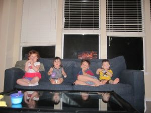 Four kids mesmerized by Toy Story